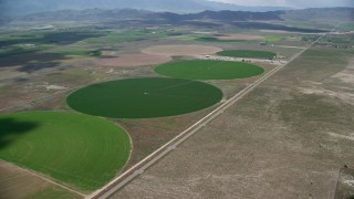 AX130_095 - 6K stock footage aerial video of approaching circular crop fields, access road, Elberta, Utah