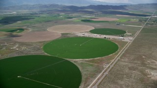 AX130_096 - 6K stock footage aerial video of flying toward circular crop fields, access road, Elberta, Utah