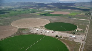 AX130_097 - 6K stock footage aerial video of approaching, flying over large circular crop fields, Elberta, Utah
