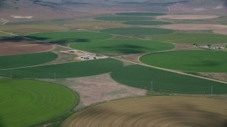 AX130_103 - 6K stock footage aerial video of a view of large field of circular crop fields, Elberta, Utah