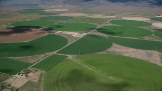 AX130_105 - 6K stock footage aerial video of flying by large field of circular crop fields, Elberta, Utah