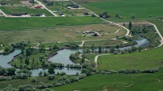AX130_112 - 6K stock footage aerial video of a barn and Burraston Ponds, Mona, Utah