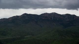 AX130_122 - 6K stock footage aerial video of passing by a peak in the Wasatch Range, Salt Creek Peak, Utah