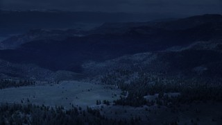 AX130_129_DFN - Aerial stock footage of 4K day for night color corrected aerial footage of flying over mountains, trees in Wasatch Range, Utah
