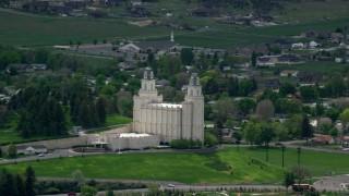 AX130_145 - 6K stock footage aerial video of orbiting the Manti-Utah Temple near neighborhoods, Manti, Utah