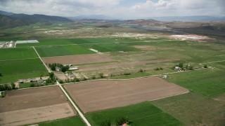AX130_147 - 6K stock footage aerial video of flying over farmland near Gunnison Reservoir, Manti, Utah