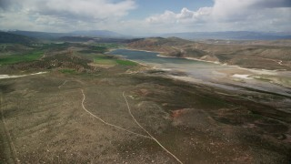 AX130_150 - 6K stock footage aerial video of approaching the Gunnison Reservoir with low water, Sanpete County, Utah