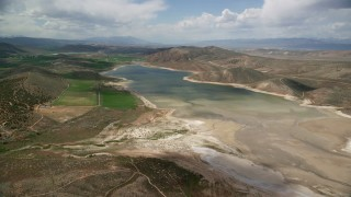 AX130_151 - 6K stock footage aerial video of flying toward Gunnison Reservoir with low water, Sanpete County, Utah