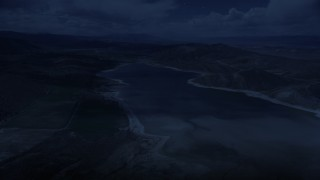 AX130_152_DFN - Aerial stock footage of 4K day for night color corrected aerial footage of flying over Gunnison Reservoir, low water, Sanpete County, Utah
