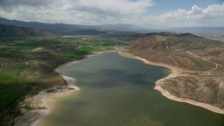 AX130_153 - 6K stock footage aerial video of the Gunnison Reservoir, low water, Sanpete County, Utah