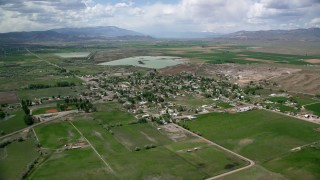 AX130_161 - 6K stock footage aerial video of approaching a rural town, farms, and Redmond Lake, Redmond, Utah