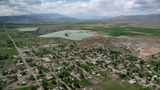 AX130_162 - 6K stock footage aerial video of flying over rural town and approaching Redmond Lake, Redmond, Utah