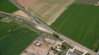 AX130_172 - 6K stock footage aerial video of flying by rural homes, Old Highway 89, Aurora, Utah