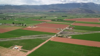 AX130_189 - 6K stock footage aerial video of flying by farmland, Route 118, Richfield, Utah