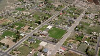 AX130_238 - 6K stock footage aerial video of orbiting Wayne High School in small rural town, Bicknell, Utah