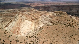 AX130_295 - 6K stock footage aerial video of approaching a box canyon from over a mesa, Capitol Reef National Park, Utah