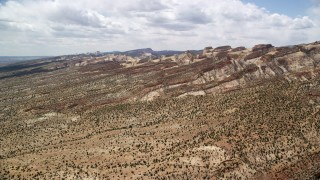 AX130_301 - 6K stock footage aerial video approach the Waterpocket Fold rock formations, Capitol Reef National Park, Utah