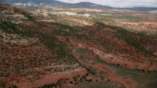 AX130_339 - 6K stock footage aerial video of approaching canyons, mountains, Capitol Reef National Park, Utah