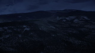 AX130_350_DFN - Aerial stock footage of 4K day for night color corrected aerial footage of flying by low, green mountains, Dixie National Forest, Utah