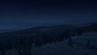 AX130_360_DFN - Aerial stock footage of 4K day for night color corrected aerial footage of flying over mountain ridge, approaching mountains, Dixie National Forest, Utah