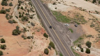 AX130_375 - 6K stock footage aerial video of tracking a black SUV on Route 12, Boulder, Utah
