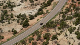 AX130_376 - 6K stock footage aerial video of a black SUV on Route 12, Boulder, Utah