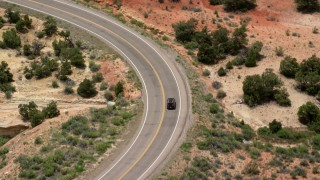 AX130_378 - 6K stock footage aerial video of a black SUV traveling Route 12 in Boulder, Utah