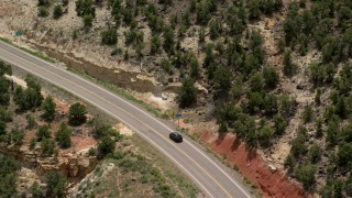 AX130_381 - 6K stock footage aerial video of tracking a black SUV, Route 12, revealing silver sedan, Boulder, Utah