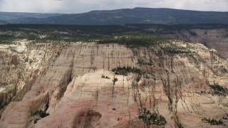 AX130_383 - 6K stock footage aerial video of flying by a mountain peak, Grand Staircase-Escalante National Monument, Utah