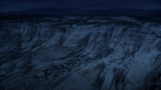 AX130_384_DFN - Aerial stock footage of 4K day for night color corrected aerial footage of approaching, flying over a canyon, Grand Staircase-Escalante National Monument, Utah