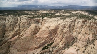 AX130_385 - 6K aerial stock footage video of flying over a rocky canyon, Grand Staircase-Escalante National Monument, Utah