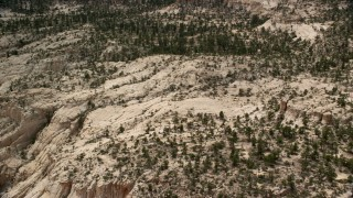 AX130_387 - 6K stock footage aerial video of rocky hills, desert vegetation, trees, Grand Staircase-Escalante National Monument, Utah