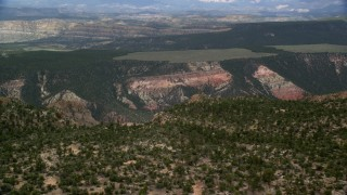 AX130_389 - 6K stock footage aerial video fly over mountain ridge, reveal canyon, Hells Backbone Road, Grand Staircase-Escalante National Monument, Utah