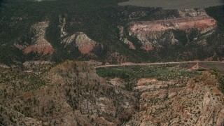 AX130_390 - 6K stock footage aerial video of approaching a canyon, Hells Backbone Road, Grand Staircase-Escalante National Monument, Utah