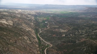 AX130_392 - 6K stock footage aerial video of flying by Hells Backbone Road, tilt to Escalante, Grand Staircase-Escalante National Monument, Utah
