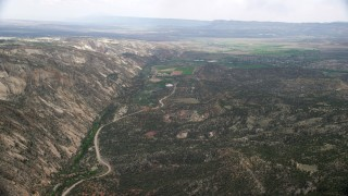 AX130_393 - 6K stock footage aerial video of flying by Hells Backbone Road leading to Escalante, Grand Staircase-Escalante National Monument, Utah