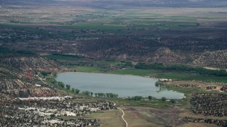 AX130_400 - 6K stock footage aerial video of a view of Wide Hollow Reservoir, Grand Staircase-Escalante National Monument, Utah