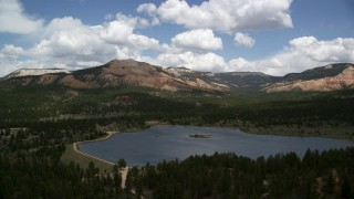 AX130_416 - 6K stock footage aerial video of flying by Barney Top Mesa, seen from Pine Lake, Barney Top Mesa, Utah