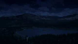 AX130_416_DFN - Aerial stock footage of 4K day for night color corrected aerial footage of flying by Barney Top Mesa, seen from Pine Lake, Utah