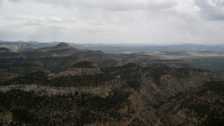 AX130_417 - 6K stock footage aerial video of flying by mountain ridges, Grand Staircase-Escalante National Monument, Utah