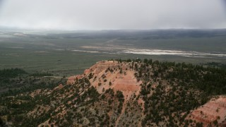 AX130_422 - 6K stock footage aerial video of flying by radio towers on a ridge, dry lake in background, Bryce Canyon National Park, Utah