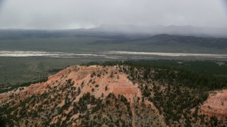 AX130_423 - 6K stock footage aerial video of radio towers on a mountain ridge, dry lake in background, Bryce Canyon National Park, Utah