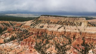 AX130_430 - 6K stock footage aerial video of flying by groups of hoodoos, mesa, Bryce Canyon National Park, Utah