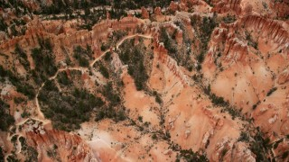 AX130_434 - 6K stock footage aerial video bird's eye view of hoodoos, buttes, dirt roads, dry riverbed, Bryce Canyon National Park, Utah