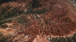 AX130_484 - 6K stock footage aerial video tilt and fly away from groups of hoodoos and buttes, Bryce Canyon National Park, Utah