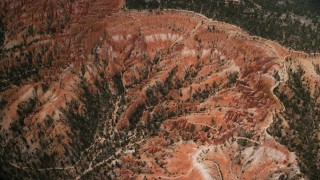 AX130_487 - 6K stock footage aerial video approach, tilt to buttes and hoodoos, Bryce Canyon National Park, Utah