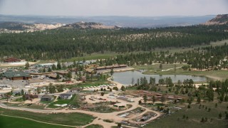 AX131_001 - 6K stock footage aerial video of a small town, hotels outside of Bryce Canyon National Park, Bryce, Utah