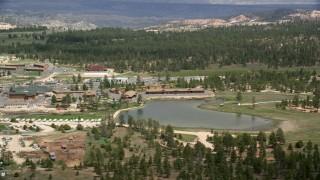AX131_002 - 6K stock footage aerial video of orbiting small town, hotels outside Bryce Canyon National Park, Bryce, Utah