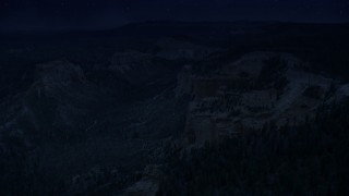 AX131_013_DFN - Aerial stock footage of 4K day for night color corrected aerial footage approach cliff near Swamp/Mud Canyon Buttes, Bryce Canyon National Park, Utah