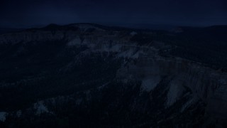 AX131_026_DFN - Aerial stock footage of 4K day for night color corrected aerial footage approach and flyby rock formations, Pink Cliffs, Bryce Canyon National Park, Utah